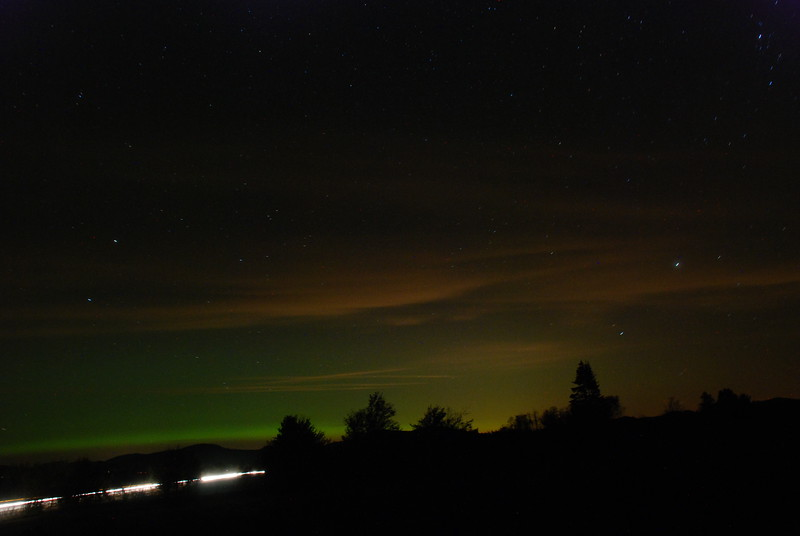 Taken 9/26/11 south of Gabriels looking northward. The green is the aurora borealis. Most of the red/orange are ground lights reflecting off clouds. Exposures between 1-2 seconds. Here you see automobile lights along Route 86.