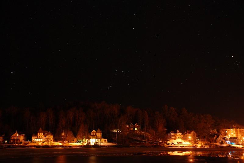 Orion over houses on Lake Flower