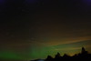 Taken 9/26/11 south of Gabriels looking northward. The green is the aurora borealis. Horizontal red/orange are mainly ground lights reflecting off clouds. Exposures between 1-2 seconds. An airplane can also be seen in this exposure