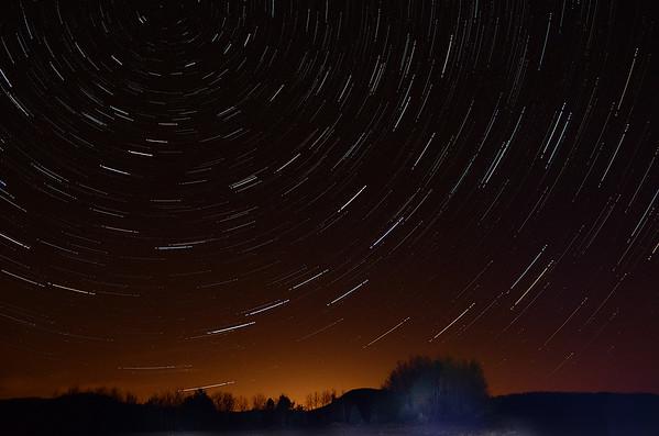 Star trails over lit horizon, Gabriels, NY - November 15, 2012