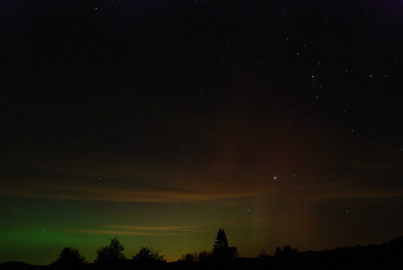 Taken 9/26/11 south of Gabriels looking northward. The green is the aurora borealis. Horizontal red/orange are mainly ground lights reflecting off clouds.