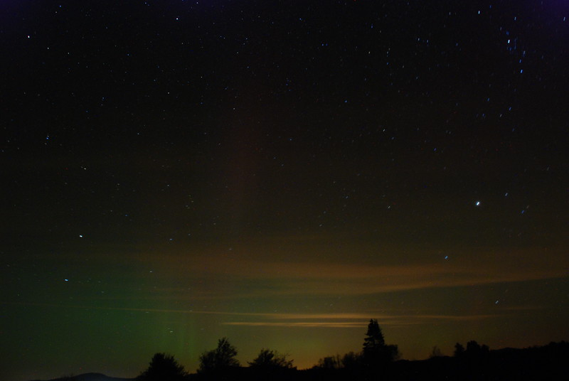 Taken 9/26/11 south of Gabriels looking northward. The green is the aurora borealis. Horizontal red/orange are mainly ground lights reflecting off clouds. Exposures between 1-2 seconds.