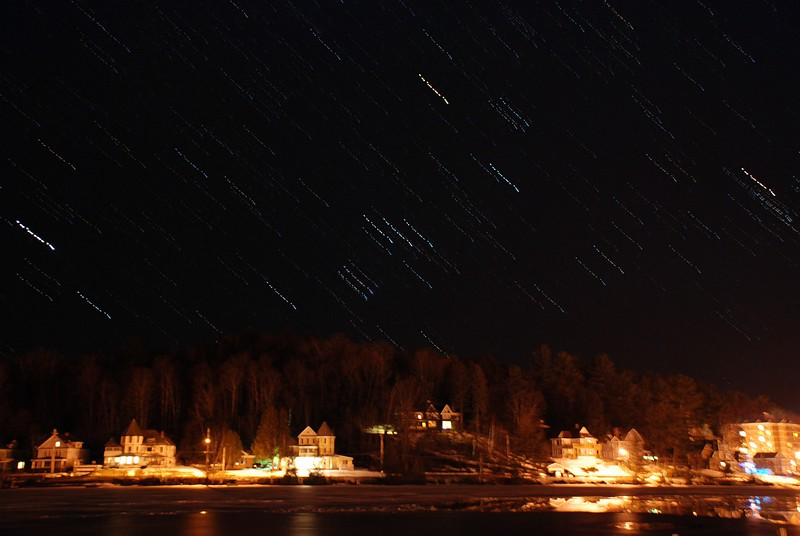 Orion over houses on Lake Flower (stacked images)