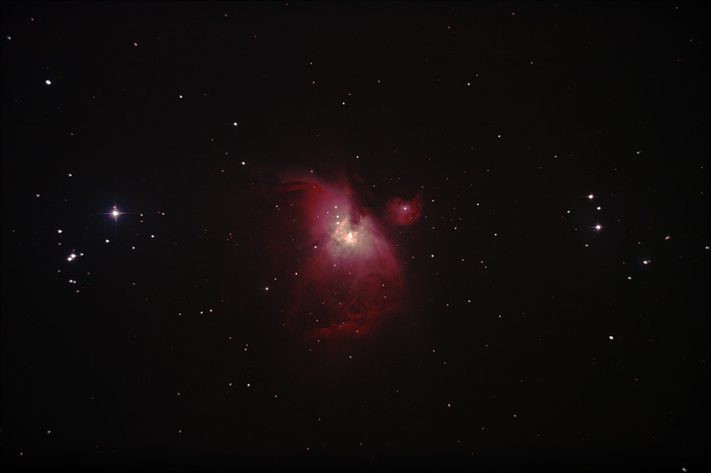 """Messier M42 NGC1976 Orion Nebula and NGC1977 Running Man Nebula - 14/04/2012 (Processed stack)<br /> <br /> Prime focus of a borrowed 8"""" f/4 Newtonian. You can see the beginings of coma distortion on stars half way from the centre increasing toward the corners and shows why short focal ratio Newtonians need these to flatten the field. This was late in the year for M42 so it was low in my western skyglow and lacks detail and definition and the running man nebula in the star group to the ight is barely visible. Also see cropped version.<br /> <br /> DeepSkyStacker 3.3.2 Stacked 85% of 6 Images ISO 800 120 Sec, 32 DARK, 0 BIAS, 0 FLATS, Post-processed by Photoshop CS5<br /> <br /> Telescope - Bintel BT200 f/4.0 Newtonian with no Coma corrector (borrowed from Stephen Boyd), Hutech IDAS LPS-P2 filter, Canon 400D DSLR, Ambient 15C. Mount - Skywatcher NEQ6 Pro. Guidescope - Orion ShortTube 80 with Star Shoot Auto Guider."""