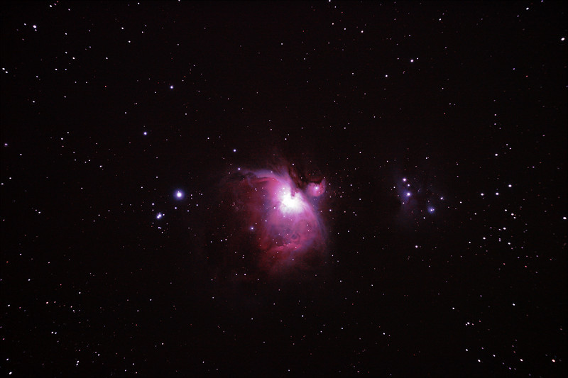 Messier M42 NGC1976 Orion Nebula - 3/1/2011 (Processed stack)<br /> <br /> The 'Great Orion Nebula' is located in the sword of Orion and is one of the brightest nebula in the sky, and perhaps the best known. It is a young star formation region with very hot high-UV stars ionising and 'lighting' the nebula.The brightness of these young stars make this an astrophotography challenge as the central regions are very bright in comparison to the tenous outer nebula and over exposure becomes a problem. High Dynamic Range (HDR) techniques must be used to produce an image with a 'flattened' brightness range, more akin to the way the human eye perceives a wide range of brightness.<br />  <br /> To the northeast (right as shown) of the Orion Nebula is the 'Running Man Nebula' a blue reflection nebula, caused by reflected light on a dark non-ionised region of nebulosity.<br /> <br /> HDR re-attempt, done in early 2012, using DeepSkyStacker 3.3.2 Stacking 80% of:<br /> 12 Images ISO 800, 15 Sec, 6 DARK, 0 BIAS, 0 FLATS (see also separate stack)<br /> 6 Images ISO 800, 30 Sec, 32 DARK, 0 BIAS, 0 FLATS (see also separate stack)<br /> 20 Images ISO 800, 120 Sec, 11 DARK, 0 BIAS, 0 FLATS (see also separate stack)<br /> Post processed with Adobe Photoshop CS5<br /> <br /> Telescope - Apogee OrthoStar LOMO 80/480 with Hotech SCA T-Adapter, Hutech IDAS LPS-P2 filter, Canon 400D DSLR, Ambient xxC (not recorded). Mount - Skywatcher NEQ6 Pro. Guidescope - Orion ShortTube 80 with Star Shoot Auto Guider.