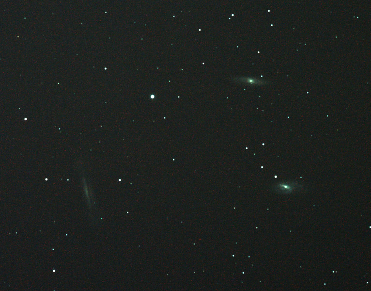Messier M65 & M66 and NGC3628 Leo Triplet Galaxies - 2/2/2011 (Processed cropped stack)<br />  <br /> First attempt at this nice compact group of 3 galaxies about 35 Million LY distant. Dark skies and more imaging time would improve this.This cropped field is just over 1 degree across (2 moon diameters).<br /> <br /> DeepSkyStacker 3.3.2 Stacked 85% of 6 Images ISO 800 180 Sec, 6 DARK, 0 BIAS, 0 FLATS, Post-processed by Photoshop CS5<br /> <br /> Telescope - Apogee OrthoStar LOMO 80/480 with Hotech SCA Field Flattener, Hutech IDAS LPS-P2 filter, Canon 400D DSLR, Ambient xxC. Mount - Skywatcher NEQ6 Pro. Guidescope - Orion ShortTube 80 with Star Shoot Auto Guider.