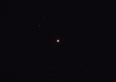 "Antares - Alpha Scorpii - 3/11/2010 (Processed JPEG)  Antares is commonly known as the ""Heart of the Scorpion"" due to its prominent location within the constellation Scorpio. A ""Red Giant"" star, clearly red to the naked eye and often mistaken for Mars due to its brightness and colour.  Single in-camera JPEG 10sec at ISO-800 with no darks, no field flattener, with  a light polution filter.  Things to note are the red and blue hot pixels due to lack of dark processing and image noise due to lack of image stacking.  Telescope - Apogee OrthoStar LOMO 80/480 without Field Flattener, Hutech LPS-P2 light pollution filter, Canon 400D DSLR, Ambient xxC not noted. Mount - Skywatcher NEQ6 Pro. Guidescope - Orion ShortTube 80 with Star Shoot Auto Guider."