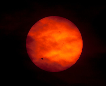 Venus Transit 2012 - a shot with less clouds and quite an array of sunspots - 8:20 6/6/2012