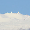 Probably the nicest picture you will ever see of Mauna Kea taken from onboard a ship at sea, hand-held, shooting towards the horizon etc., etc.<br /> Right to Left: CFHT, Gemini, UH 2.2m, UKIRT telescopes (I think!)