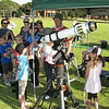 28th November 2009 saw the International Year of Astronomy (IYA) celebrated with public afternoon information display and presentations and an evening telescope observing session at Curtin Uninversity. This shot of one of the voluntary telescope participants doing solar observing using a solar filter.