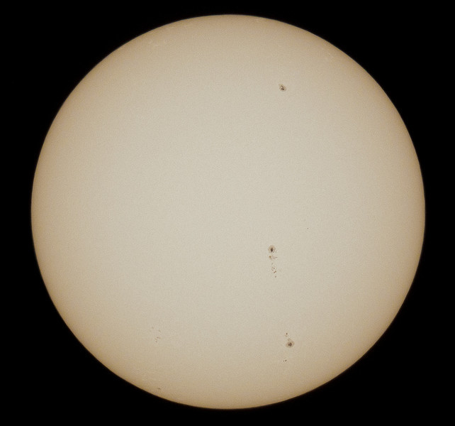 An hour before the eclipse - note the sun spots! Taken with my Nikon D300 on my Astro-Physics Traveler (105mm aperture F/6)