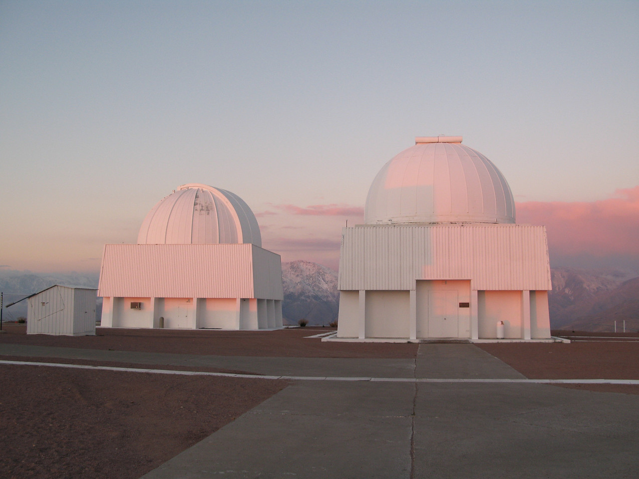 0.9 and 1m telescopes with the snow covered mountains in the background