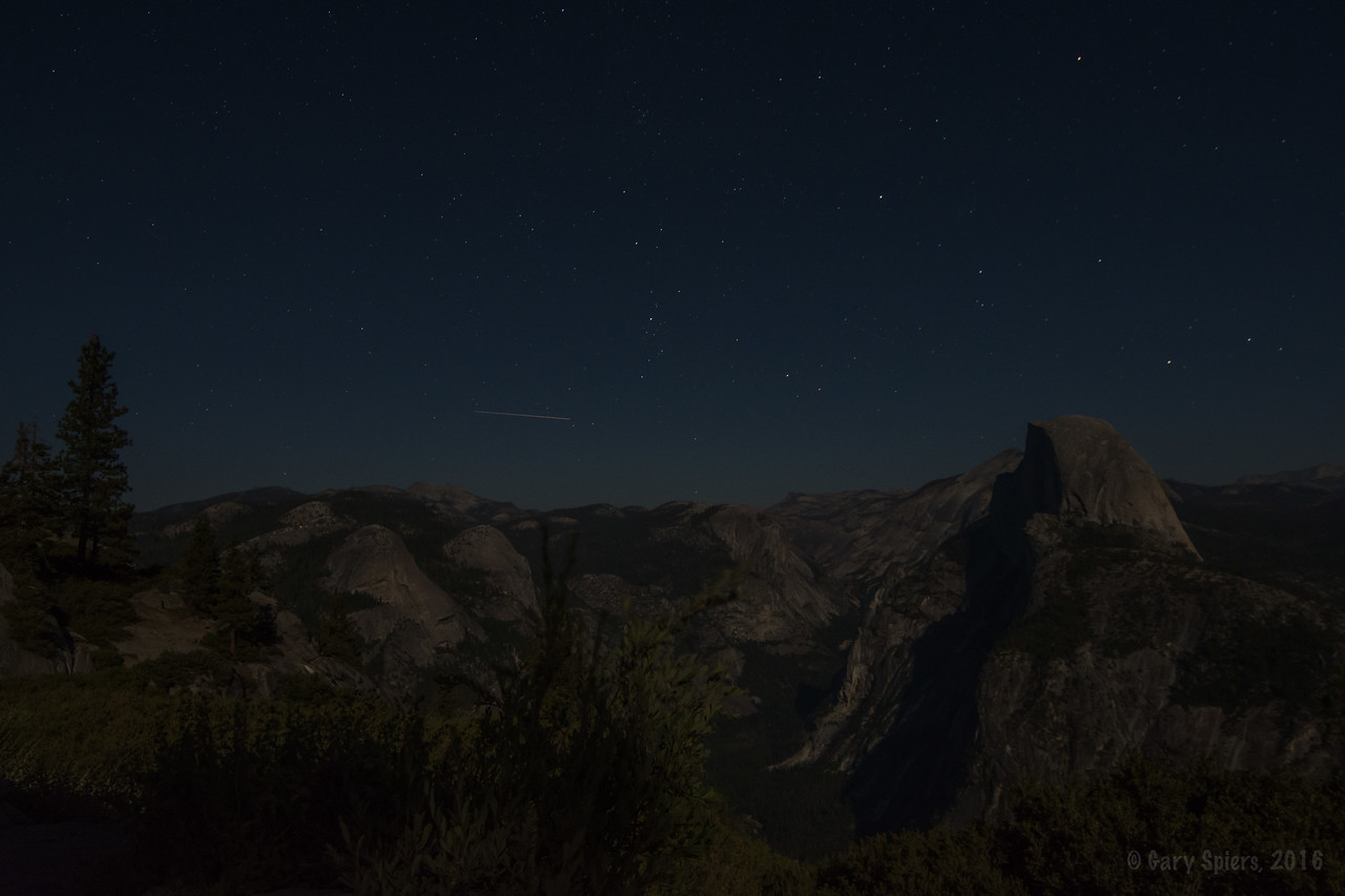 A meteor below Cassiopeia. Across the valley is a faint red light (need full size image to see it) - probably a climber camping for the night.