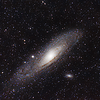 Andromeda galaxy (M31). Closest galaxy to our own. Moving in our direction, and will eventually collide with our galaxy.