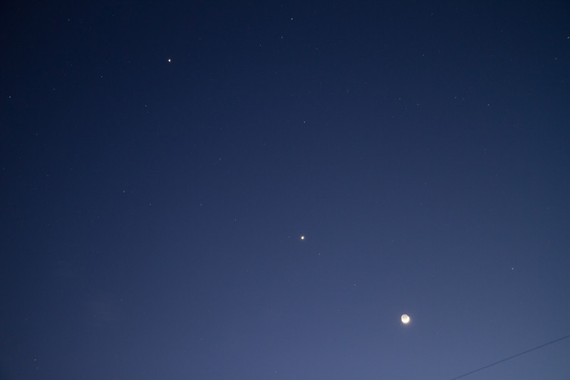 Crescent moon at the bottom with Venus next up and Jupiter at the very top. Canon 7D 17-55 f2.8.