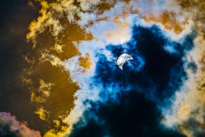 Solar Eclipse Through Clouds 1
