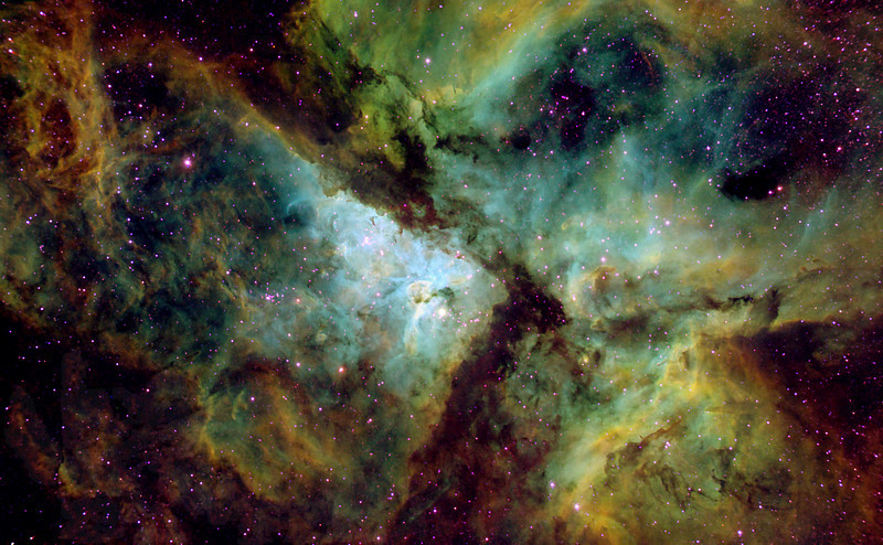 NGC 3372 aka ETA Carina<br /> The Carina Nebula (also known as the Great Nebula in Carina, the Eta Carinae Nebula, or NGC 3372) is a large bright nebula that surrounds several open clusters of stars. Eta Carinae and HD 93129A, two of the most massive and luminous stars in our Milky Way galaxy, are among them. The nebula lies at an estimated distance between 6,500 and 10,000 light years from Earth. It is located in the constellation of Carina. The nebula contains multiple O-type stars.<br /> <br /> This nebula is one of the largest H II regions in the Milky Way. It has a visual magnitude of 1.0. The astronomical coordinates are:<br /> <br /> R.A.: 10h 43.8m <br /> Dec.: −59° 52' <br /> The nebula is one of the largest diffuse nebulae in our skies. Although it is some four times as large and even brighter than the famous Orion Nebula, the Carina Nebula is much less well known, due to its location far in the Southern Hemisphere. It was discovered by Nicolas Louis de Lacaille in 1751–52 from the Cape of Good Hope.<br /> *************************************************************************<br /> Processed using HST palette Red=SII Green=Ha Blue=OIII.<br /> **************************************************************************<br /> Captured using:<br /> Camera: OSC QHY8 as main and QHY5 as guide|<br /> Filters: SII 8nm (23x20min), Ha 7nm (4x20min), OIII 8.5nm (6x15min)|<br /> Captured using Nebulosity 2 and PHD for guiding|<br /> Scope: WO FLT-110 Triplet f/7|<br /> Mount: HEQ5 Pro|<br /> Processed: IP v3.75|