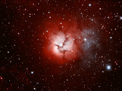"M20 - Trifid Nebula| The Trifid Nebula (catalogued as Messier 20 or M20 and as NGC 6514) is an H II region located in Sagittarius. Its name means 'divided into three lobes'. The object is an unusual combination of an open cluster of stars, an emission nebula (the lower, red portion), a reflection nebula (the upper, blue portion) and a dark nebula (the apparent 'gaps' within the emission nebula that cause the trifid appearance, it is around 2000-9000 light years away and about 16 light years in diameter. ********************************************************************************************** Processed using SRGB Red=Ha Green=Ha+Oiii Blue=Oiii ************************************************************************** Captured using: Camera: QHY9 CCD (mono KAF 8300 chip) as main and QHY5 as guide| Filters: Ha 7nm (11x20min), OIII 8.5nm (5x20min) Bin2| MPCC Field Flattener Captured using Nebulosity 2 and PHD for guiding| Scope: GSO RC 8"" f/8