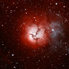 "M20 - Trifid Nebula|<br /> The Trifid Nebula (catalogued as Messier 20 or M20 and as NGC 6514) is an H II region located in Sagittarius. Its name means 'divided into three lobes'. The object is an unusual combination of an open cluster of stars, an emission nebula (the lower, red portion), a reflection nebula (the upper, blue portion) and a dark nebula (the apparent 'gaps' within the emission nebula that cause the trifid appearance, it is around 2000-9000 light years away and about 16 light years in diameter.<br /> **********************************************************************************************<br /> Processed using SRGB Red=Ha Green=Ha+Oiii Blue=Oiii<br /> **************************************************************************<br /> Captured using:<br /> Camera: QHY9 CCD (mono KAF 8300 chip) as main and QHY5 as guide|<br /> Filters: Ha 7nm (11x20min), OIII 8.5nm (5x20min) Bin2|<br /> MPCC Field Flattener<br /> Captured using Nebulosity 2 and PHD for guiding|<br /> Scope: GSO RC 8"" f/8