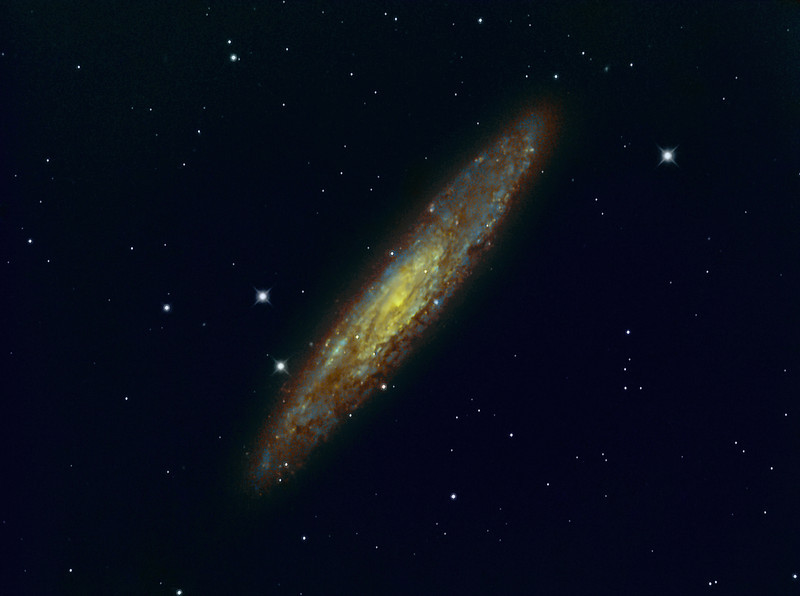 "NGC 253 Reprocessed|<br /> NGC 253 is a spiral galaxy and is around 10 million light-years away, it is considered as a starburst galaxy because of high star formation rates and dense dust clouds in it's necleus.<br /> **********************************************************************************************<br /> Processed using HST palette Red=Sii Green=Ha Blue=Oiii.<br /> **************************************************************************<br /> Captured using:<br /> Camera: QHY9 CCD (mono KAF 8300 chip) as main and QHY5 as guide|<br /> Filters: SII 8nm (16x20min) Bin2, Ha 7nm (17x20min), OIII 8.5nm 11x20min) Bin2|<br /> MPCC Field Flattener<br /> Captured using Nebulosity 2 and PHD for guiding|<br /> Scope: GSO RC 8"" f/8