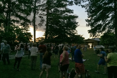 At totality, it was dark enough overhead for stars to appear, but clouds on the horizon were brightly illuminated.