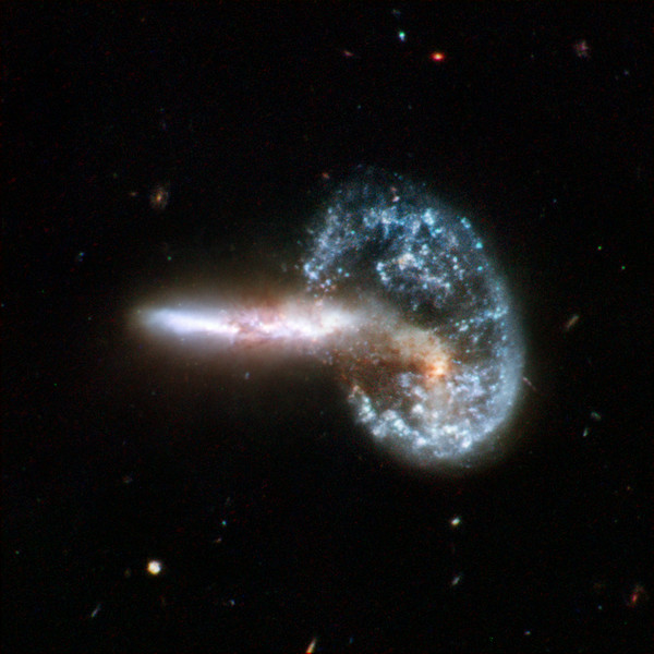 Hubble image of Arp 148.  A new generation of gigantic land-based telescopes using adaptive optic and multiple mirrors will produce pictures with several times the resolution of the Hubble.