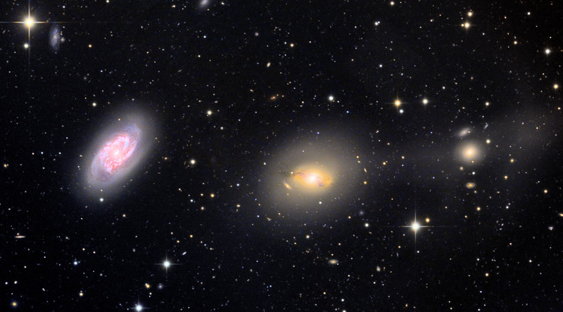 NGC 2964 (left), NGC 2968 (center), NGC 2970 (right), and other more distant galaxies.  2964 and 2968 are spiral galaxies, and 2970 is an elliptical galaxy.  The hazy band or plume appearing to extend between 2968 and 2970 may represent distortion due to galactic interaction, a previously dissolved galaxy, supernova remnants, or have another explanation - but it real and has been noted by others.  32 inch Schulman telescope with STX camera on Mt. Lemmon, AZ.  Data capture and reduction by Adam Block, University of Arizona.  LRGB processing by JDS using CCDStack, Photoshop CS6, and Noise Ninja.