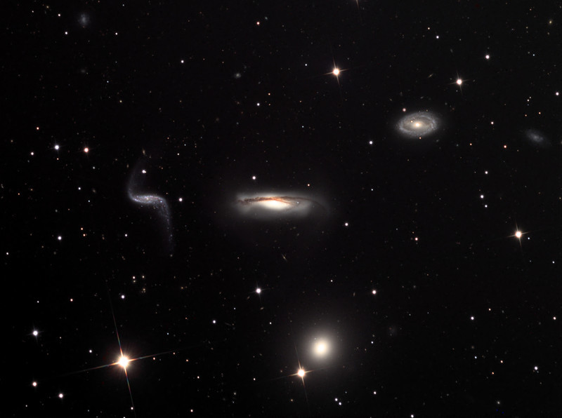 "NGC 3190, an experimental semi-synthetic image with one galaxy ""moved"" from its original sky location.  Same data and processing as following image."