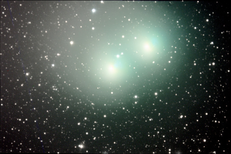 Comet Macholz in February, 2005. Double exposure reveals movement of comet head against stellar background.
