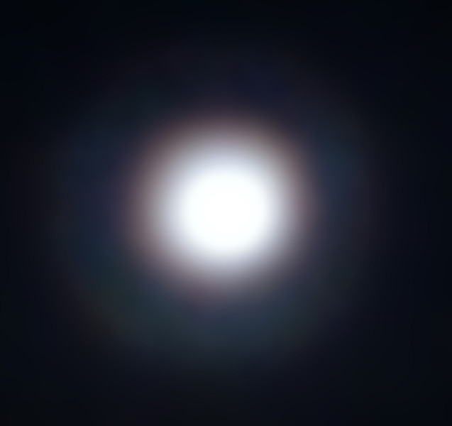 Moonglow at Palm Springs.  Remarkable halo due to unusual atmospheric conditions.  iPhone image processed in Photoshop.