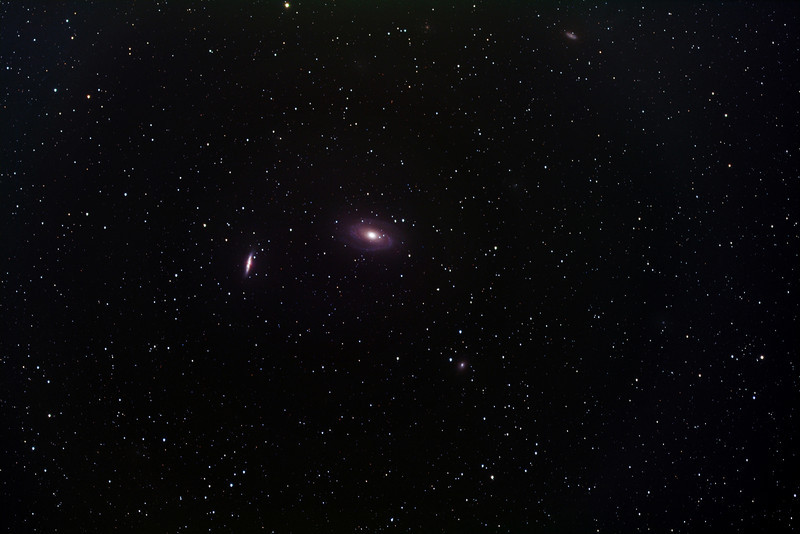 """M81/M82 galaxy region, uncropped, FSQ 106 telescope at f/5 + 11000M camera. LRGB, 160 total minutes. Enlargement of original, which can be downloaded at full resolution, reveals at least 5 very faint, """"small"""" galaxies in addition to the 4 identified in the preceding frame."""