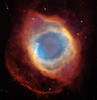 Helix planetary nebula, image from the Hubble space telescope and the 4 meter Blanco telescope in Chile for comparison.