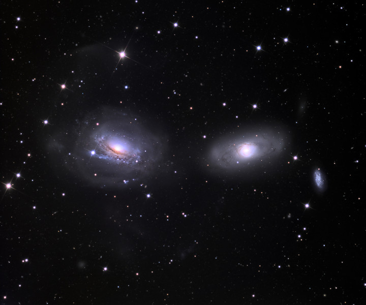 Gravitationally interacting galaxies NGC3169 (left) and NGC3166, with the more remote NGC3165 at right.  32 inch Schulman telescope with STX camera on Mt. Lemmon, AZ.  Data capture and reduction by Adam Block, University of Arizona.  LRGB processing by JDS using CCDStack and Photoshop CS6.  In memory of Jo (Joann) Douglas.