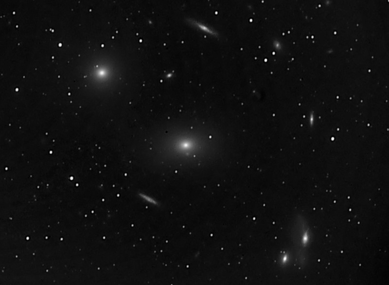 Messier 84 and Messier 86 galaxies, with additional galaxies; very early uncolored image, Takahashi refractor.