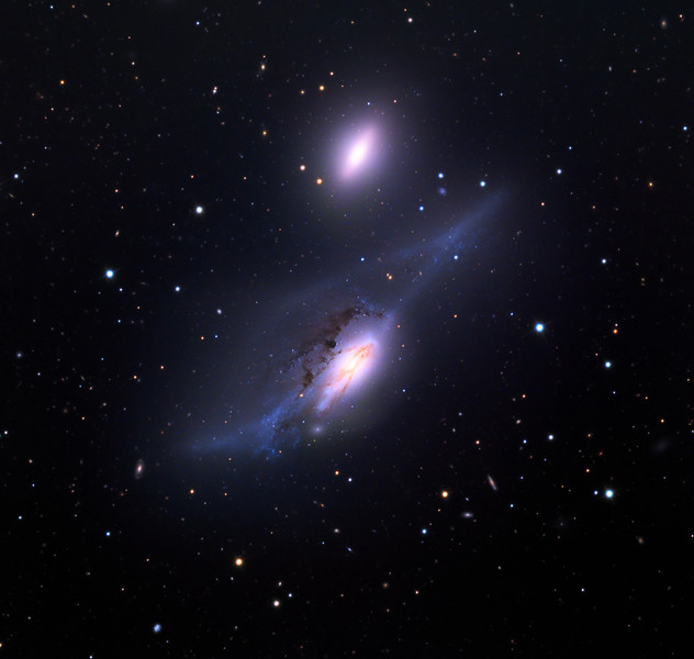 NGC 4438 (lower) and NGC 4435 (upper) galaxies.  Also known as the Eye Galaxies or Arp 120.  Schulman telescope 32 inch with STX camera on Mt. Lemmon, AZ.  Data capture and reduction by Adam Block, University of Arizona.  LRGB processing by JDS using CCDStack, Noise Ninja, and Photoshop CC.