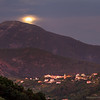 19/09/2013 – 19:43 Harvest moon rising above the Ligurian Apennine mountains and the resort of Tassano in Sestri Levante, Liguria, Genoa Italy