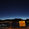 """Comet PanSTARRS is above the right edge of the """"Keep Off Ice"""" sign."""