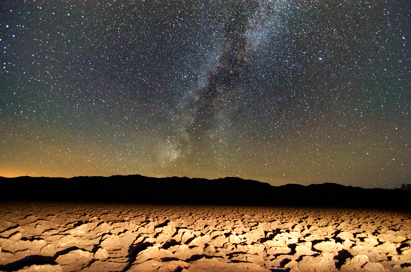 The view from Devil's Golf Course in Death Valley, showing light from the Los Angeles basin.