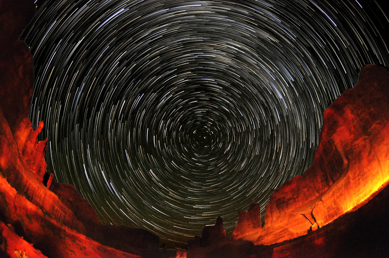 Circular star trails form around Polaris, The North Star, looking down the Park Avenue formation in Arches National Park, Utah.  The name for the formation comes from the impression that the viewer is look down a city street with tall buildings on either side.  This is a compilation of over 200 images, combined in a unique way so as to make the star trails look like comets.
