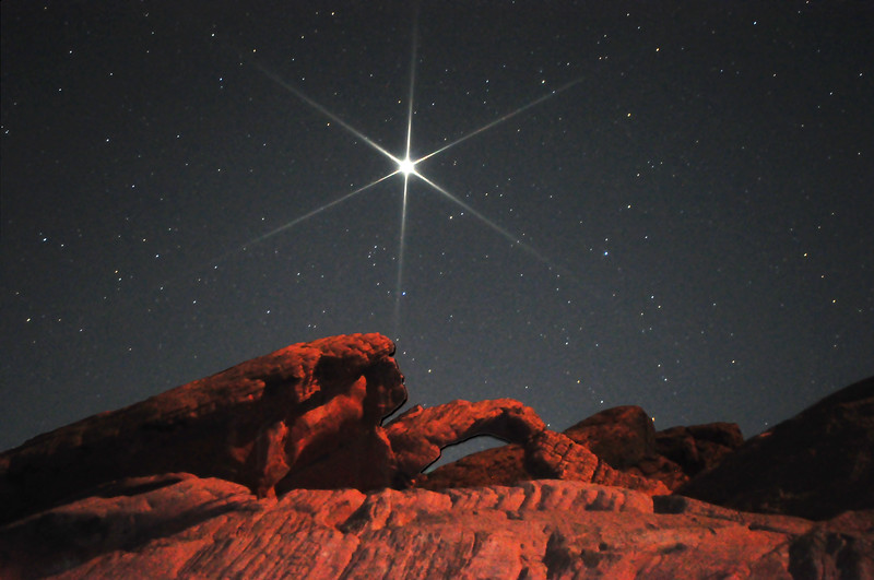Jupiter rises over Arch Rock in Valley of Fire, Nevada