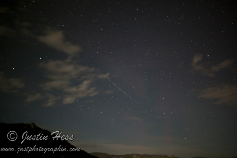 A Perseid meteor streaked across the sky.  The other streak below and to the right is a plane or satellite.