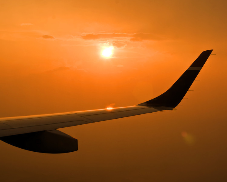 Starboard Wing Sunset... US Air flight from Philadelphia to Jacksonville. The smoke from the nearby forest fire helped create this beautiful sunset during our decent over north Florida.