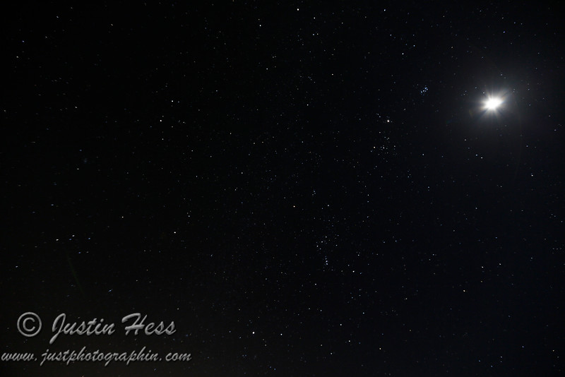 A different exposure length, aperture setting and even more of a wide angle shot from the last shot.  Part of Gemini should be in the upper left above Orion; Sirius is the brightest star in the lower left which is left of Lepus below Orion; Orion near the center; Part of Taurus should be going across to the right of Orion; Pleiades is pointing at Jupiter to the left, which is the next largest bright dot compared to the moon in the upper right; Part of Eridanus is visible in the lower right starting at the foot of Orion.