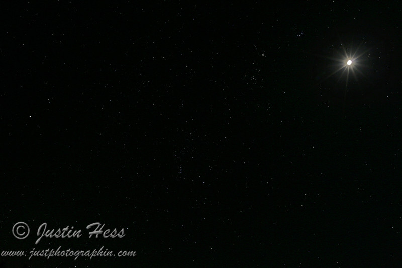 A slightly wider angle of the last photo.  Part of Gemini should be in the upper left above Orion; Sirius is the brightest star in the lower left which is left of Lepus below Orion; Orion near the center; Part of Taurus should be going across to the right of Orion; Pleiades is pointing at Jupiter to the left, which is the next largest bright dot compared to the moon in the upper right; Part of Eridanus is visible in the lower right starting at the foot of Orion.