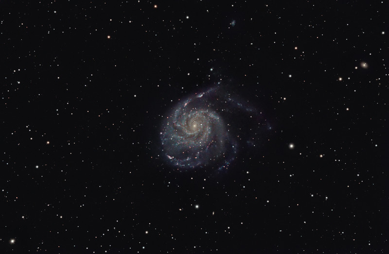 Target: M101 (NGC 5457, Pinwheel Galaxy, spiral galaxy in Ursa Major, apparent dimension 28.8 x 26.9 arcmin, magnitude 7.9)<br /> <br /> Distance from Earth:  27 million light-years<br /> <br /> Image FOV: 76 x 50 arcmins (maximum FOV:  82 x 55 arcmins)<br /> <br /> Date/Time:  04/26/09 2211 EDT to 04/27/09 0442 EDT<br /> <br /> Mount: Takahashi NJP Temma II<br /> <br /> Telescope: Takahashi TOA-130 refractor with Tak 0.98x flattener (f/7.5) and Hutech LPS filter<br /> <br /> Camera: Starlight Xpress SXVF-M25C guided by SX Autoguider with Takahashi FS-60C refractor (f/5.9)<br /> <br /> Focus: Finger Lakes Instrumentation DF-2 with FocusMax/MaxIm DL software<br /> <br /> Sky conditions:  transparency 4/5, seeing 3/5<br /> <br /> Moonset:  04/26/09 2235 EDT<br /> <br /> Images: Captured with MaxIm DL 4.60 at an image scale of 1.64 arcsec/pixel; 28 light exposures, 600 sec duration; 3, 600 sec dark frames; 27, 0.55 sec flat_light frames and 27, 0.1 sec bias frames; 19 frames were used for alignment and stacking<br /> <br /> Processing: MaxIm DL 5.00 and Photoshop CS3 with Neat Image, Astronomy Tools and GradientXTerminator; image cropped and downsampled (revised 06/18/09)