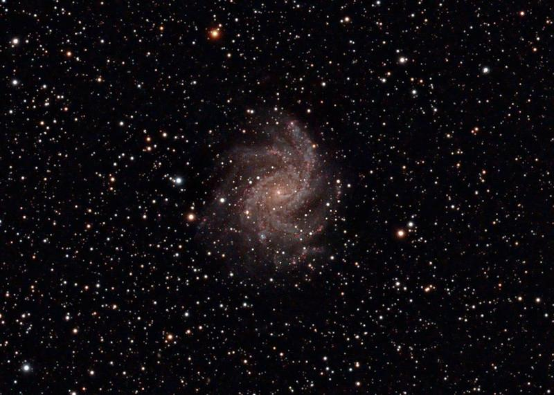 Target: Fireworks Galaxy (NGC 6946; spiral galaxy in Cepheus, apparent dimension 11 x 10 arcmin, magnitude 8.9)<br /> <br /> Distance from Earth:  10 million light-years<br /> <br /> Image FOV:  33 x 23 arcmin<br /> <br /> Date/Time: 10/25/08 1946 EDT to 10/26/08 0210 EDT<br /> <br /> Mount: Takahashi NJP Temma II<br /> <br /> Telescope: Takahashi TOA-130 refractor with Tak 0.98x flattener (f/7.5) and Hutech LPS filter<br /> <br /> Camera: Starlight Xpress SXVF-M25C ccd guided by SX Autoguider with Takahashi FS-60C refractor (f/5.9)<br /> <br /> Focus: Finger Lakes Instrumentation DF-2 focuser with FocusMax/MaxIm DL software<br /> <br /> Sky conditions:  transparency 4/5, seeing 2/5<br /> <br /> Moonrise:  10/26/08 0524 EDT<br /> <br /> Images: Captured with MaxIm DL 4.60 at an image scale of 1.64 arcsec/pixel; 29 light exposures, 600 sec duration; 1, 600 sec dark frame; 27, 1.0 sec flat_light frames; 27, 1.0 second flat_dark frame and 27, 0.1 sec bias frames; 23 frames were used for alignment and stacking <br /> <br /> Processing: MaxIm DL 5.00, DeepSkyStacker 3.2.2 and Photoshop CS3 with GradientXTerminator, Photoshop Tools and Noise Ninja; original image cropped and 3x drizzle stacked in DSS before processing in PS; image downsampled