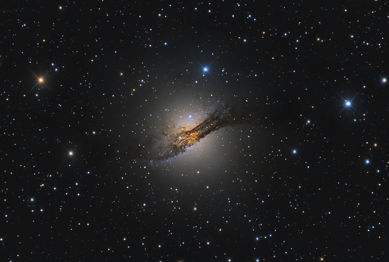 "Target:  Centaurus A (NGC 5128, peculiar galaxy in Centaurus)<br /> <br /> Distance from Earth:  15 million light-years<br /> <br /> Image FOV:  26 x 17 arcmins<br /> <br /> Telescope: RCOS 12.5"" (f/6.1)<br /> <br /> Camera: SBIG ST10XME<br /> <br /> Images: Luminance data captured at an image scale of 0.73 arcsec/pixel (binned 1x1); 37, 300 sec subexposures; 185 minutes on Mar 31 and Apr 5, 2011.  RVB data captured at an image scale of 1.46 arcsec/pixel (binned 2x2); 43, 300 sec subexposures; 65 minutes (R), 65 minutes (V) 85 minutes (B), 215 minutes on Mar 31 and Apr 5, 6, 2011; total exposure time of 400 minutes<br /> <br /> Processing: MaxIm DL 5.12, Registar 1.0 and Photoshop CS3 with GradientXTerminator and Noise Ninja; final image scale 0.73 arcsec/pixel, image cropped"