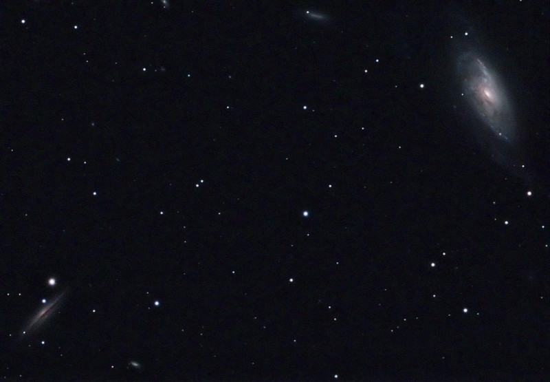 M106 (spiral galaxy in Canes Venatici, apparent dimension 19 x 8 arcmin, magnitude 8.4 on right) and NGC 4217 (spiral galaxy in Canes Venatici, apparent dimension 5.2 x1.5 arcmin, magnitude 11.3 on left)<br /> <br /> Distance from Earth:  25 million light-years<br /> <br /> Date/Time:  05/14/07, 2340 to 05/15/07 0249 EDT<br /> <br /> Mount:  Takahashi NJP Temma II<br /> <br /> Telescope:  Takahashi FS-78 (f/8.1) with Hutech IR-blocking filter<br /> <br /> Camera: Starlight Xpress SXVF-M8C ccd guided by SBIG STV with Takahashi FS-60C w/ Optec 0.62x reducer (f/3.7) and Hutech LPS filter<br /> <br /> Focus: VSE Epsilon, RoboFocus and AstroArt 4.0 autofocus plug-in<br /> <br /> Sky conditions:  transparency 3/5, seeing 3/5, wind 12-16 mph, humidity 45-50%, temp O/I 60.1/58.5 F at beginning and 54.5/57.4 F at conclusion<br /> <br /> Moon:  27.7 day old, 0.042 illuminated, mag -5.9<br /> <br /> Images:  Captured with AstroArt 4.0 at an image scale of 1.01 arcsec/pixel; 30 light exposures, 360 sec duration; no dark, flat or bias frames; 20 images used for processing<br /> <br /> <br /> Processing:  ImagesPlus 3 beta 1D, Picture Window Pro 4.0 and Photoshop CS 8.0 with GradientXTerminator and Noise Ninja