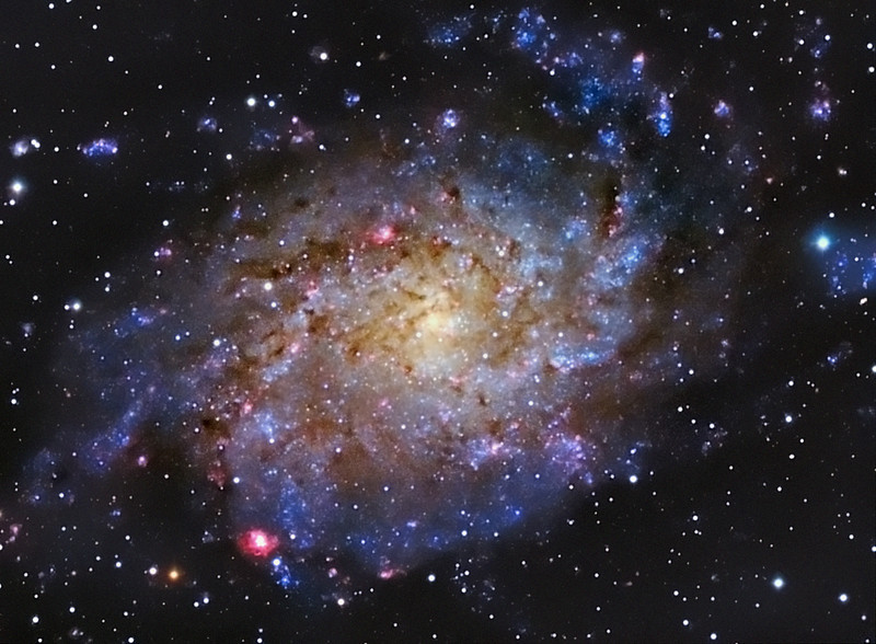 Target:  Triangulum Galaxy; M33 (NGC 598, spiral galaxy in Triangulum, apparent dimension 75x45 arcmin, magnitude 5.7)<br /> <br /> Distance from Earth:  3 million light-years<br /> <br /> Image FOV:  36 x 27 arcmin<br /> <br /> Mount: Takahashi NJP Temma II<br /> <br /> Telescope: Takahashi TOA-130 refractor with TOA-130 0.78x reducer (f/6.0) and Astrodon R, G and B filters.<br /> <br /> Camera: Starlight Xpress SXVF-H9 ccd guided by SX Autoguider with Takahashi FS-60C refractor (f/5.9)<br /> <br /> Focus: Finger Lakes Instrumentation DF-2 focuser with FocusMax/MaxIm DL software<br /> <br /> Images: Captured with MaxIm DL 4.60 at an image scale of 1.69 arcsec/pixel; 70 minutes (R), 60 minutes (G) and 140 minutes (B); total exposure time of 270 minutes on Dec 11, 2009<br /> <br /> Processing: MaxIm DL 5.05, Astronomy Tools and Photoshop CS3 with Noise Ninja and GradientXTerminator; R, G and B images processed individually, aligned and combined in MaxIm DL.  Combined image processed in PS; image cropped (revised 03/15/10)