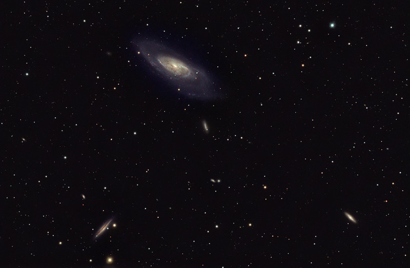 Target:  M106 (spiral galaxy in Canes Venatici, apparent dimension 19 x 8 arcmin, magnitude 8.4, top-center), NGC 4220 (spiral galaxy in Canes Venatici, apparent dimension 3.9 x1.5 arcmin, magnitude 11.3, bottom-right) and NGC 4217 (spiral galaxy in Canes Venatici, apparent dimension 5.2 x 1.5 arcmin, magnitude 11.3, bottom-left)<br /> <br /> Distance from Earth:  25 million light-years<br /> <br /> Image FOV: 79 x 52 arcmins (maximum FOV:  82 x 55 arcmins)<br /> <br /> Date/Time:  04/25/09 2130 EDT to 04/26/09 0455 EDT<br /> <br /> Mount: Takahashi NJP Temma II<br /> <br /> Telescope: Takahashi TOA-130 refractor with Tak 0.98x flattener (f/7.5) and Hutech LPS filter<br /> <br /> Camera: Starlight Xpress SXVF-M25C guided by SX Autoguider with Takahashi FS-60C refractor (f/5.9)<br /> <br /> Focus: Finger Lakes Instrumentation DF-2 with FocusMax/MaxIm DL software<br /> <br /> Sky conditions:  transparency 4/5, seeing 2/5<br /> <br /> Moonset:  04/25/09 2120 EDT<br /> <br /> Images: Captured with MaxIm DL 4.60 at an image scale of 1.64 arcsec/pixel; 31 light exposures, 600 sec duration; 3, 600 sec dark frames; 27, 0.55 sec flat_light frames and 27, 0.1 sec bias frames; 22 frames were used for alignment and stacking<br /> <br /> Processing: MaxIm DL 5.00 and Photoshop CS3 with Noise Ninja, Focus Magic, Astronomy Tools and GradientXTerminator; image cropped and downsampled (revised 06/03/09)